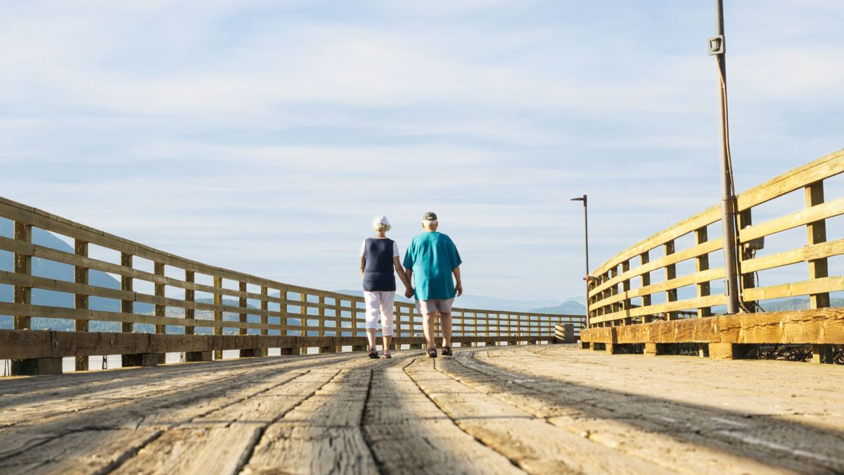 Couple walking on pier